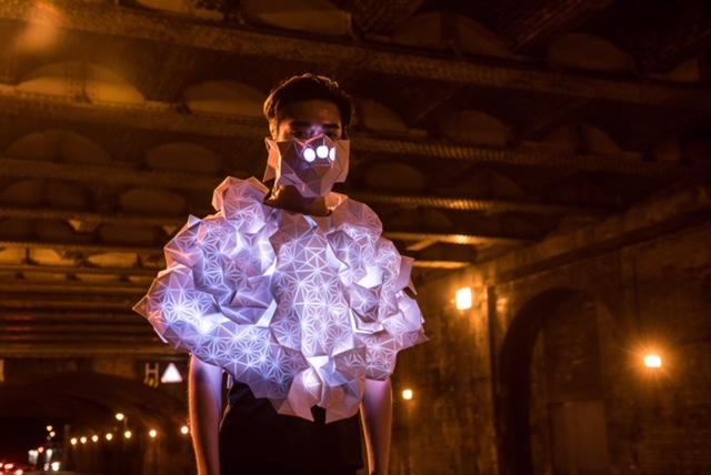 woman in illuminated costume