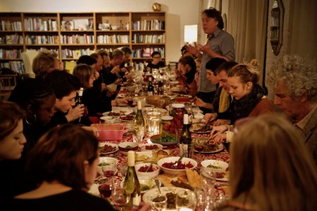 a dinner party table filled with guests and food