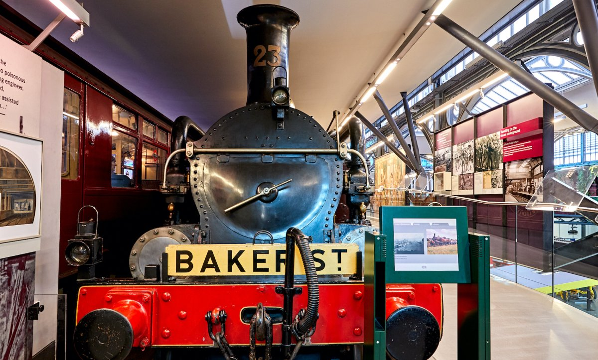 A steam train situated inside London Transport Museum